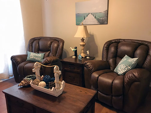 Two leather recliners and coffee table